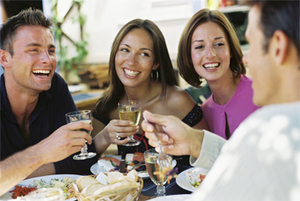 Photo of two couples enjoying appetizers and drinks